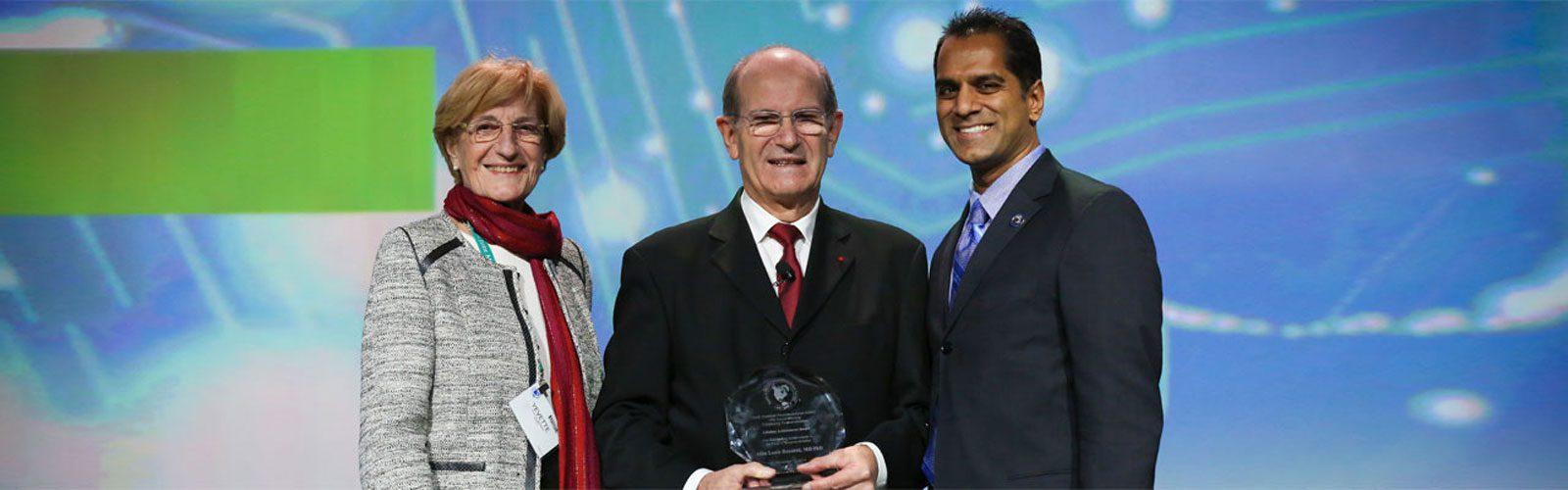 Dr. Patil with Alim-Louis Benabid, DBS pioneer